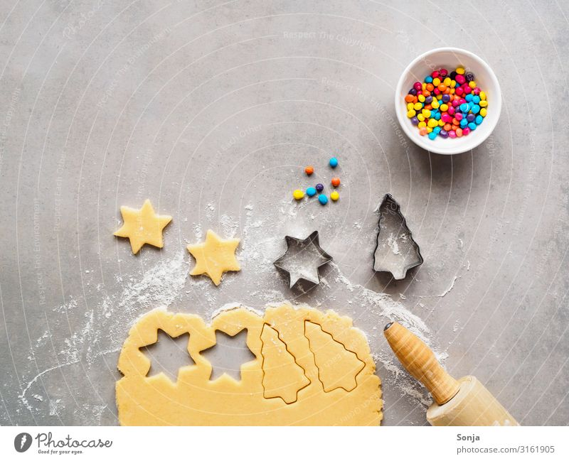 Christmas biscuits baked with colorful sprinkles Food Dough Baked goods raw dough Cookie Crockery Bowl Rolling pin Lifestyle Christmas & Advent To enjoy
