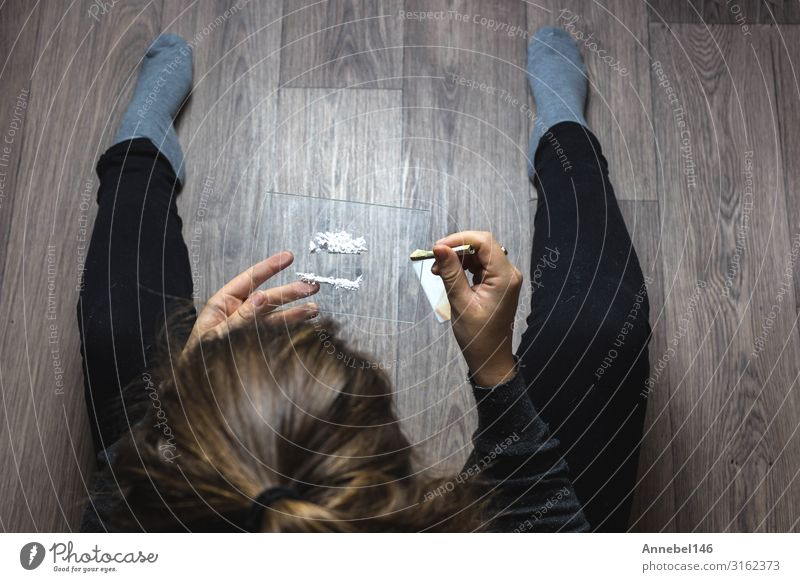 Young woman snorting drugs, cocaine or speed or other drugs Money Table Woman Adults Youth (Young adults) Hand Line Sadness Black White Loneliness addiction