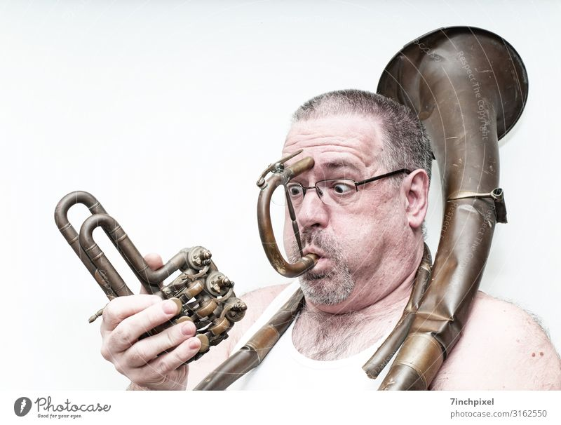 An astonished man plays a broken brass instrument Human being Masculine Man Adults Body Head Hair and hairstyles Face Eyes Ear Nose Mouth Lips Facial hair Chest