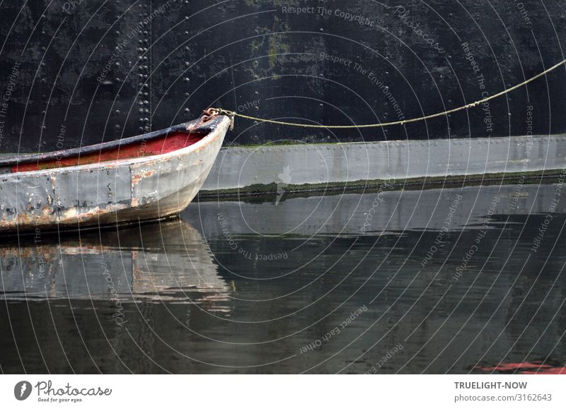 Dark, old mother ship with light, old barge in | roped party Motor barge Old Dinghy Rope Hull tie Iron Water Calm River reflection Black Red Gray moor