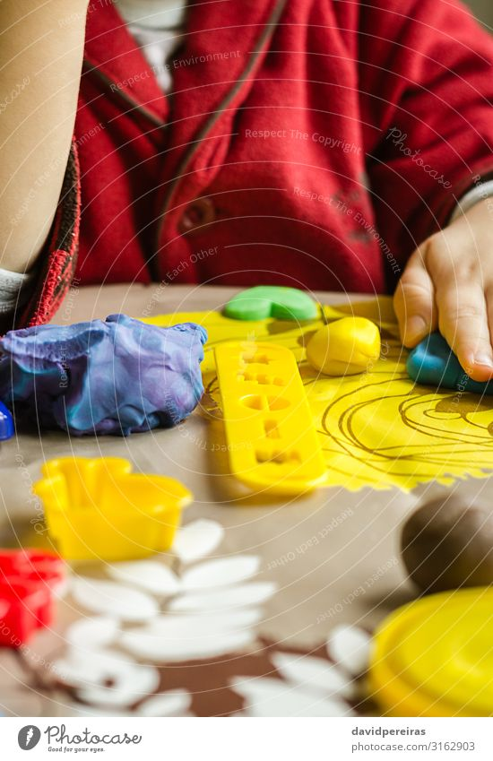 Closeup of plasticine molds and child hands on the background Dough Baked goods Joy Playing Table Child Boy (child) Infancy Toys Cute Creativity Action Clay