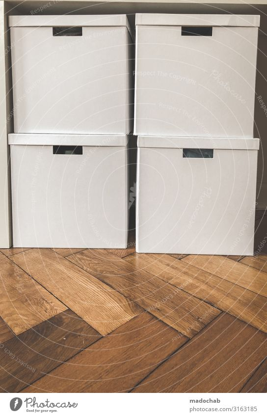 Packed - stacked cartons Storage Order Lifestyle Living or residing Flat (apartment) Interior design Clean White Protection Attentive Disciplined Orderliness
