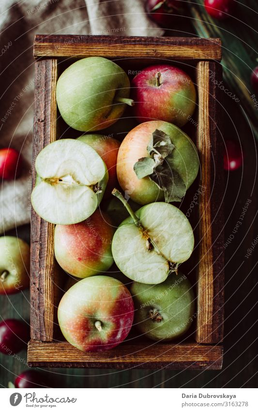 Ripe garden apples in a wooden crate sweet fresh autumn juicy healthy background food delicious nature natural harvest table organic diet season ripe farm top