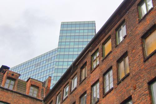 Facades of an old brick house and a modern high-rise building one behind the other Sky Clouds Autumn Hamburg Port City Downtown Deserted