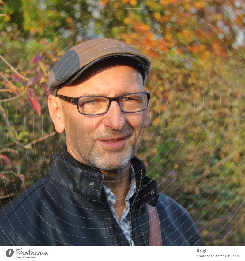 Portrait of a friendly smiling man with beard, glasses and cap Human being Masculine Man Adults Male senior Senior citizen 1 45 - 60 years Environment Nature