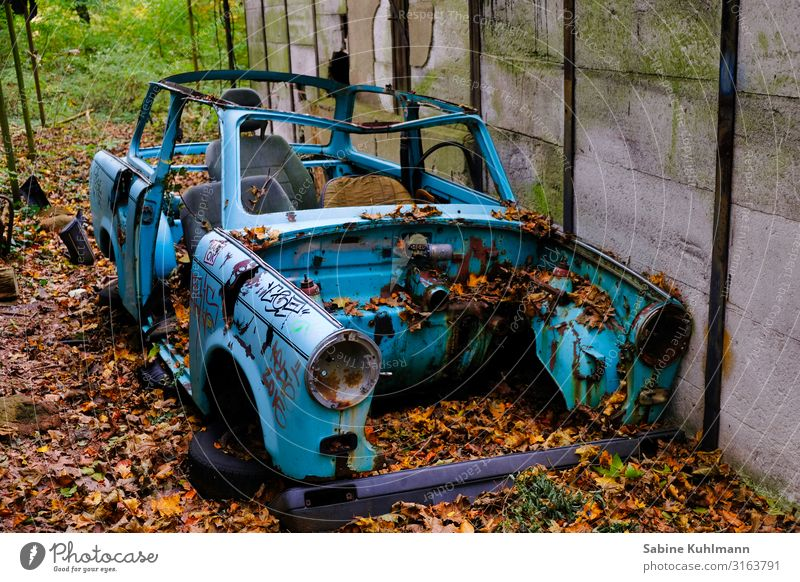 Trabant Vehicle Car Trabbi Old Dirty Broken Blue Senior citizen Town Decline Past Transience Change Autumn Colour photo Exterior shot Deserted Day
