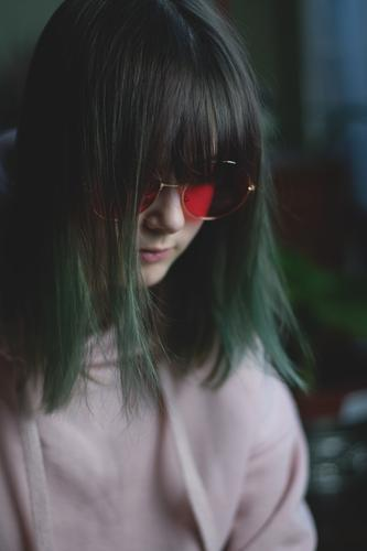 Child Youth (Young adults) Young woman Girl Dark Face Sadness Hair and hairstyles Retro Meditative Eyeglasses Reading Watchfulness Boredom Seventies Hippie