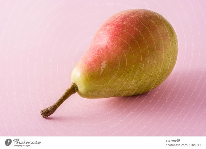 Healthy fresh pear on pink background Healthy Eating Green Red Food photograph Natural Fruit Tradition Vegetarian diet Vegan diet Vitamin Snack Pear