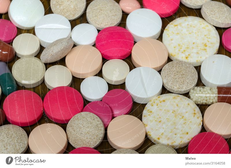 Various pills and capsules on the table Healthy Concepts &  Topics Tin Pill Red Medication Pharmacy Healthy Eating The pill Pharmaceutical industry Capsule