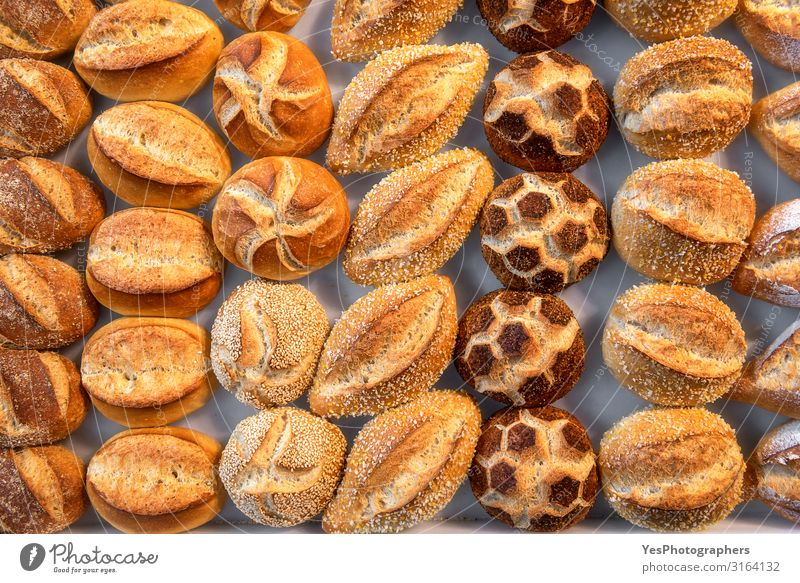 Bread buns diversity. Cute decorated bread rolls. Bavarian rolls Roll Nutrition Shopping Healthy Eating Fresh Small Yellow Tradition above view assortment