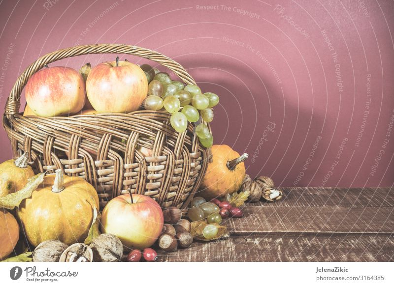 Basket with autumn harvest Vegetable Fruit Apple Nutrition Eating Vegetarian diet Lifestyle Design Table Nature Plant Autumn Leaf Wood Old Fresh Natural Sweet