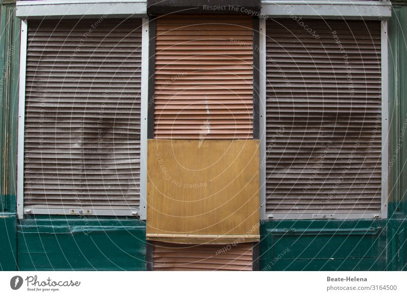 Shut down: business premises closed by shutters and wooden crate shank Store premises Closed broke business discontinuation Retail sector Economy Shop window