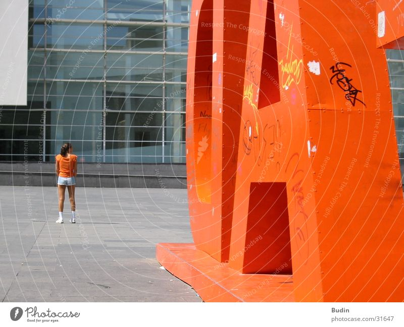 orange Woman Girl Letters (alphabet) Tin Barcelona Orange Back Backwards Glas facade Contrast