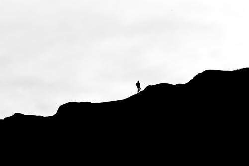 ascent Androgynous 1 Human being Nature Landscape Sky Hill Rock Mountain Movement Going Far-off places Gray Black White Moody Joie de vivre (Vitality) Longing