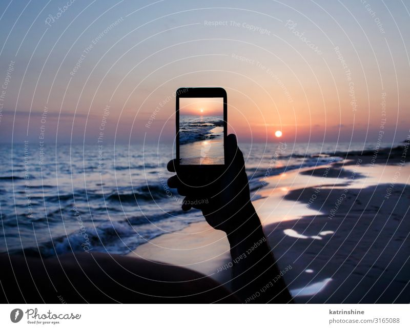 Man takes a sunset photo on the phone Vacation & Travel Summer Beach Ocean Cellphone PDA Technology Adults Hand Environment Nature Landscape Sky Dark Blue