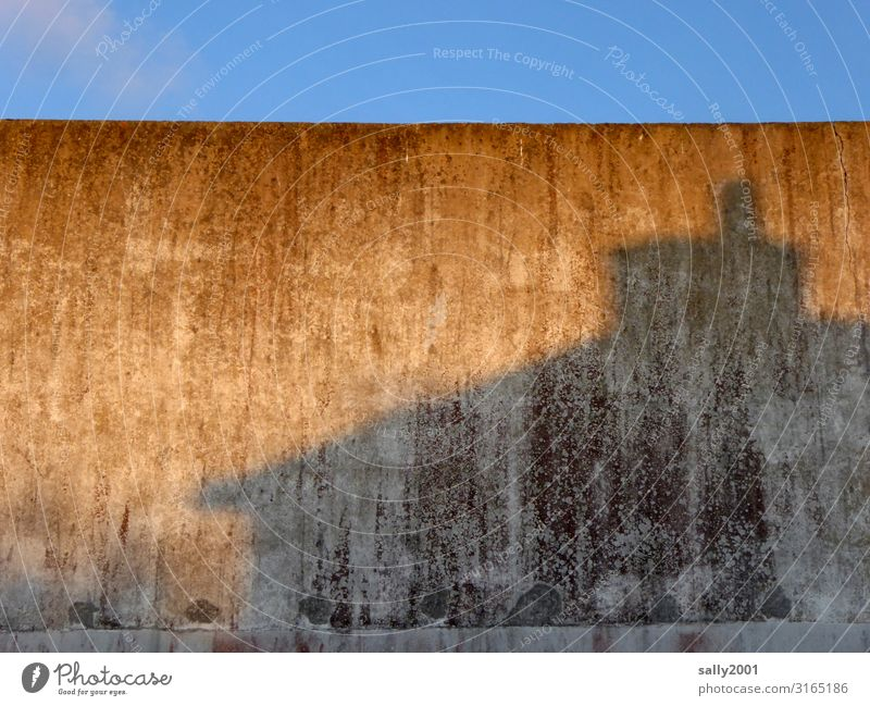 romantic concrete Wall (building) Facade Shadow shadow cast Concrete Gray evening light Twilight Old Contrast built windowless Wall (barrier) Weathered