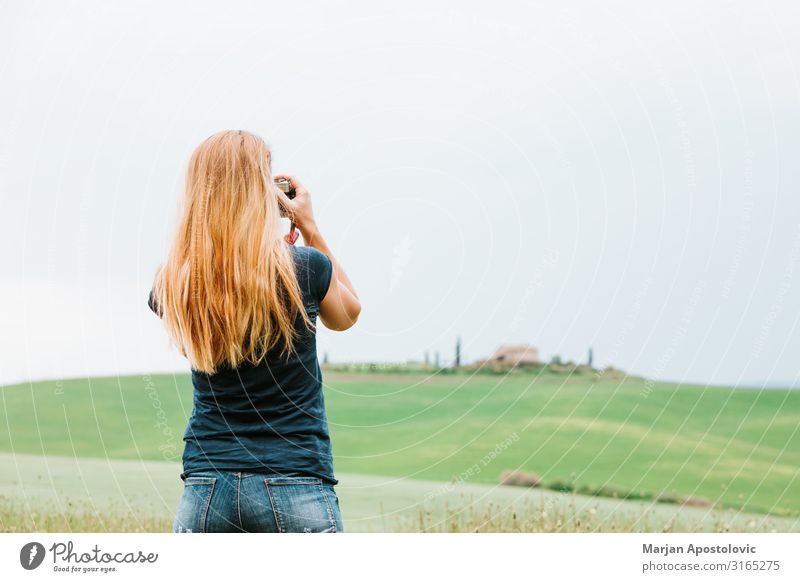 Young woman taking a photo of landscape in Tuscany Leisure and hobbies Photography Vacation & Travel Tourism Sightseeing Camera Feminine Youth (Young adults)