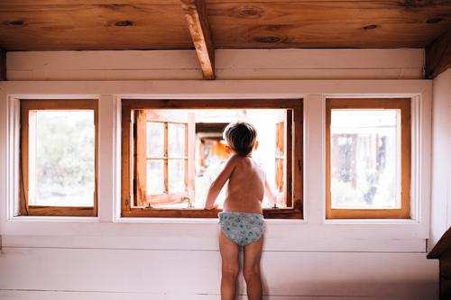 Curious Toddler looking out of cabin window Lifestyle Happy Beautiful Child Human being Natural Home people room interior Interior shot Morning Looking
