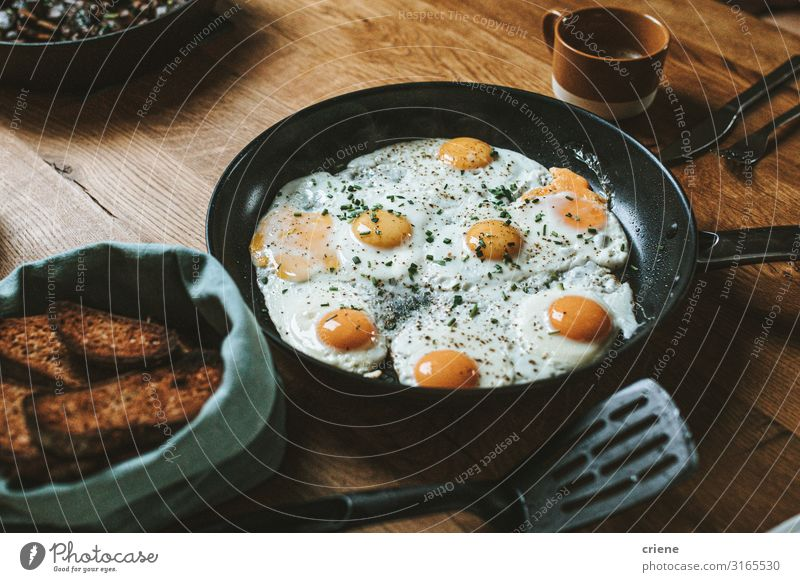 Pan with fried eggs and bread for breakfast Food Healthy Eating Dish Food photograph Meal Egg Cooking Frying Breakfast Vegetable Close-up Hot Kitchen Lunch