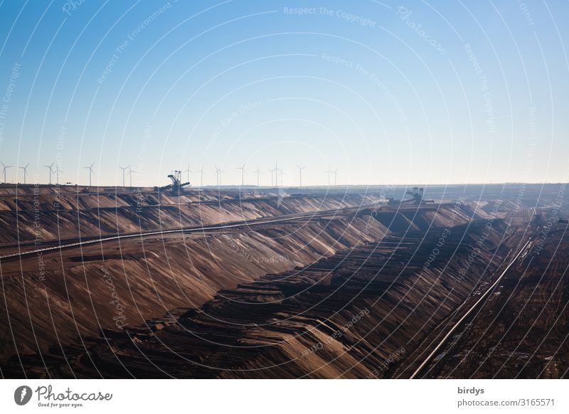 Behind the pit edge Energy industry Wind energy plant Coal power station Soft coal dredger Cloudless sky Summer Climate change Beautiful weather