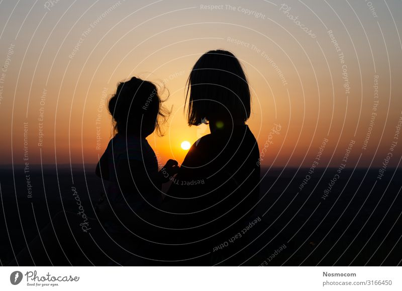 Mother and daughter who sit and look at the sunset . Joy Beautiful Vacation & Travel Freedom Summer Sun Ocean Child Baby Toddler Woman Adults Parents