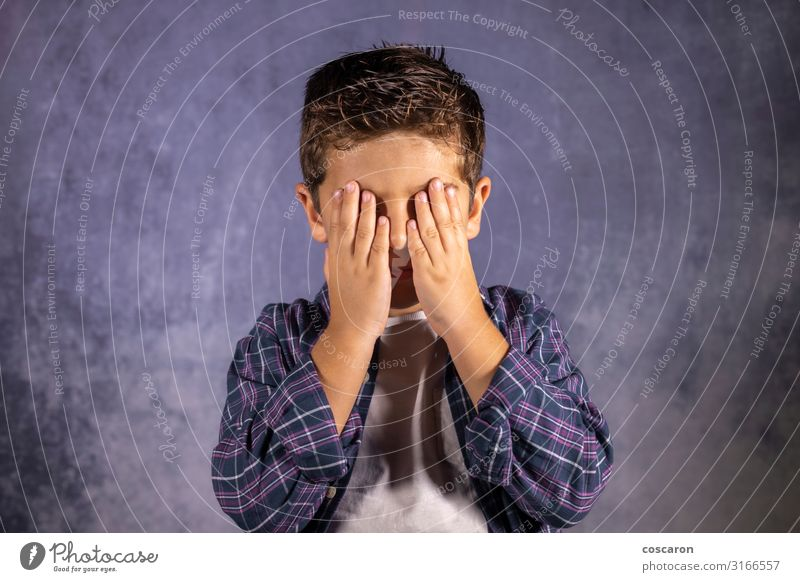 Little child covering his eyes with his hands Child Human being Man Beautiful White Hand Loneliness Joy Face Eyes Lifestyle Adults Sadness Emotions Happy