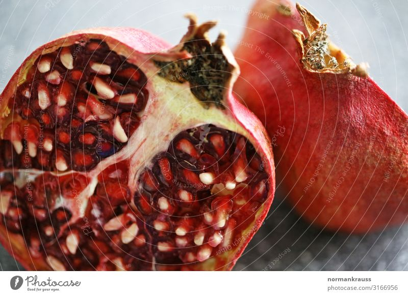 pomegranate Food Fruit Pomegranate Exotic Fresh Healthy Delicious Near Natural Orange Red Sliced Division Kernels & Pits & Stones Colour photo Interior shot