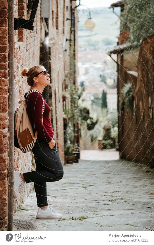 Young woman traveler in the streets of an old town Lifestyle Vacation & Travel Tourism Trip Adventure Sightseeing Human being Feminine Youth (Young adults)