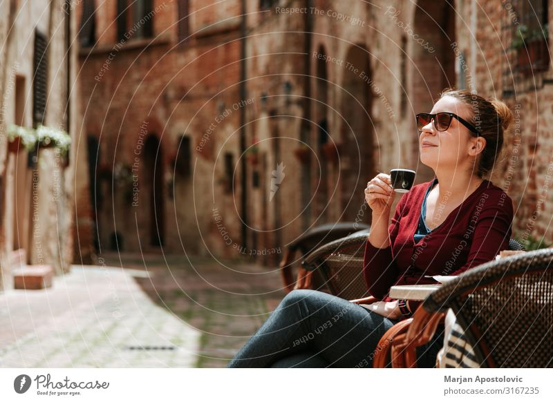 Young woman enjoying coffee in outdoor cafe To have a coffee Hot drink Coffee Espresso Mug Lifestyle Vacation & Travel Tourism Human being Feminine