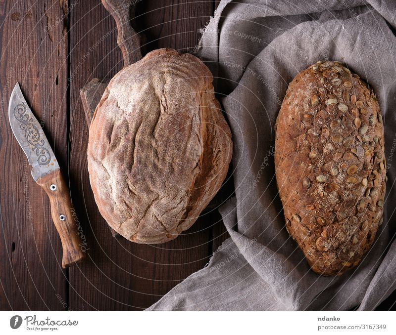 bread made from rye flour with pumpkin seeds Bread Nutrition Breakfast Diet Table Wood Fresh Natural Above Brown Gray Tradition knife Gourmet Flour Baking