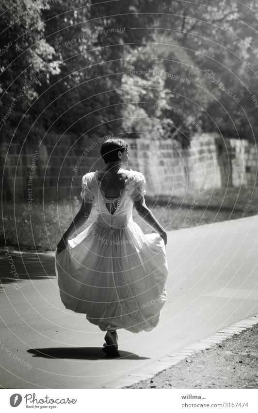short-haired woman in nostalgic wedding dress goes her way, rear view Bride Wedding dress Feminine Woman Adults Lanes & trails long dress Short-haired Going