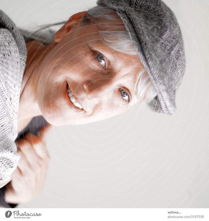 portrait of a smiling grey-haired woman with a pushcap Portrait photograph Woman Blonde Gray-haired sliding cap Peaked cap hood Smiling Laughter Friendliness