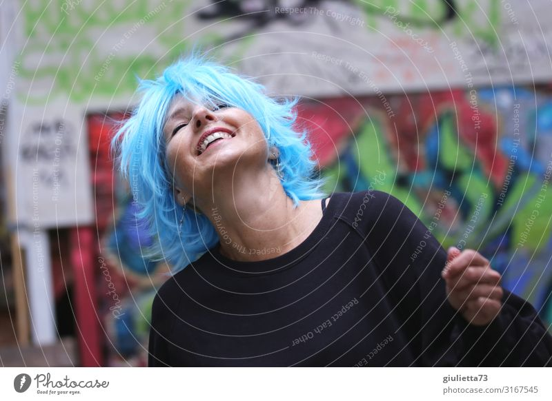 Woman Human being Blue Beautiful Joy Adults Life Graffiti Laughter Happy Freedom Smiling 45 - 60 years Joie de vivre (Vitality) To enjoy Dance
