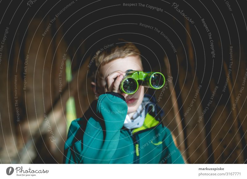 Boy looks through binoculars Leisure and hobbies Playing Adventure Far-off places Freedom Garden Parenting Education Kindergarten Child Human being Masculine