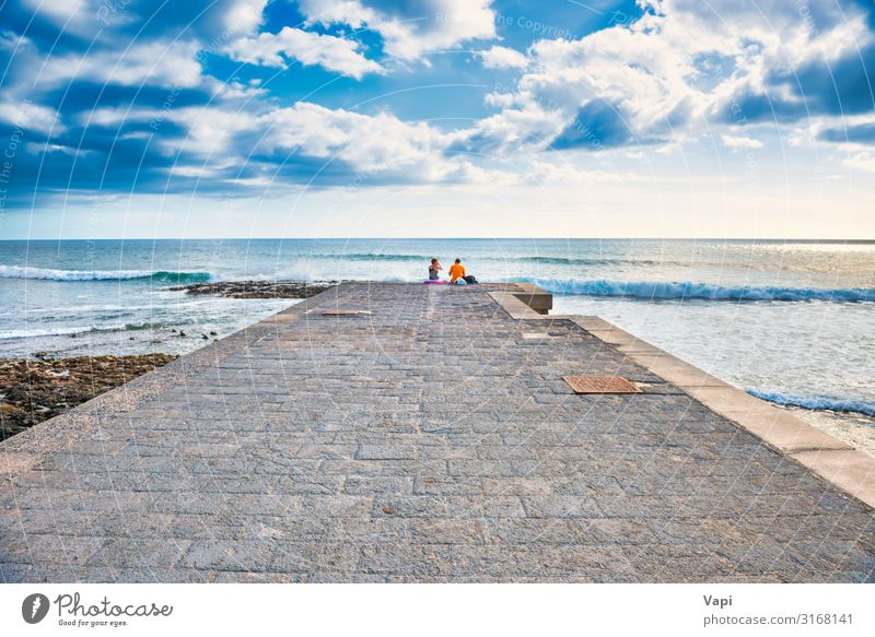 Couple people sitting on stone pier Lifestyle Joy Happy Beautiful Leisure and hobbies Vacation & Travel Tourism Trip Adventure Far-off places Freedom Summer