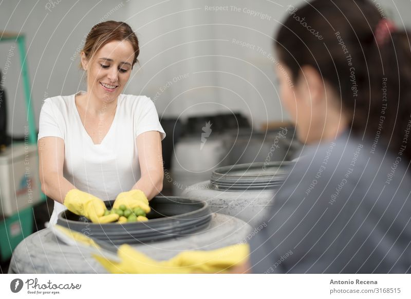 Worker women controlling olives fermentation Fruit Work and employment Profession Workplace Factory Industry Business Technology Woman Adults Partner 2