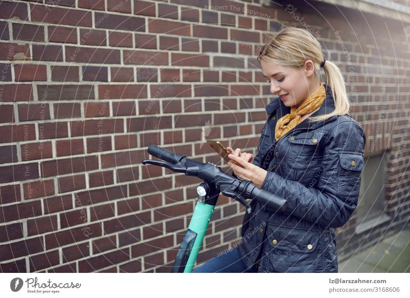 Trendy young blond woman booking e-scooter Face Reading PDA Technology Woman Adults 1 Human being 18 - 30 years Youth (Young adults) Environment Transport
