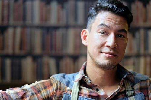 Portrait in front of book wall Masculine Man Adults Face 1 Human being 30 - 45 years Book Library Shirt Suspenders Black-haired Cool (slang) Friendliness