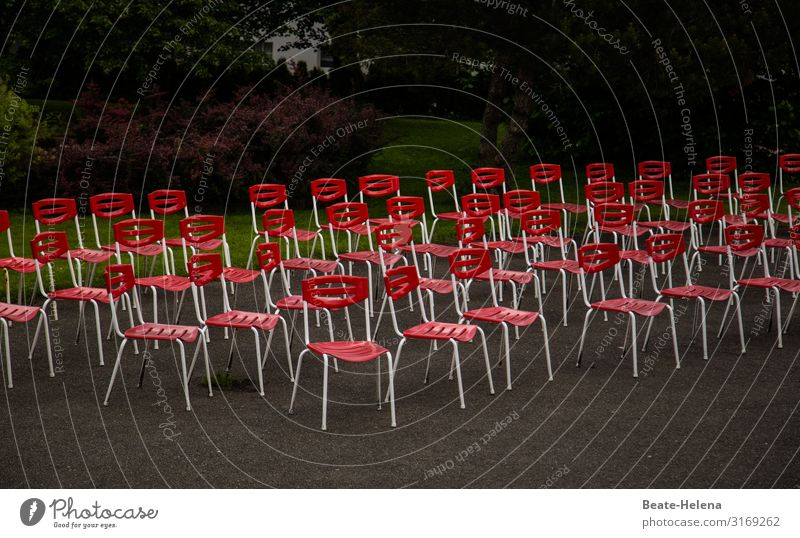Corona sends its regards: numerous unoccupied chairs in the park coronavirus Red unmanned out Empty Seating Deserted Loneliness Gastronomy Places Free Furniture