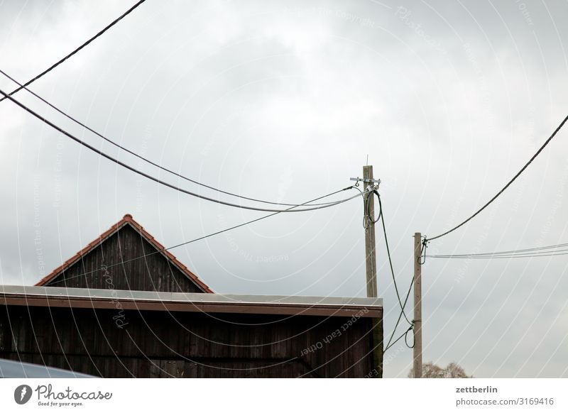 Village with cables Mountain House (Residential Structure) Barn Gable Roof Pole Electricity pylon Telegraph pole Telephone line Transmission lines left