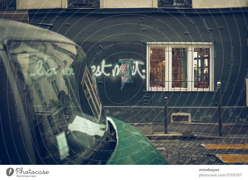 Rainy street in Paris Tourism City Town Facade Window Zebra crossing Car Old Discover Uniqueness Broken Wet Retro Green Black Loneliness Transience Graffiti