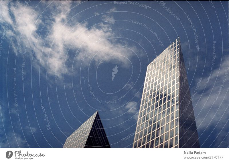 Sky in a glass Clouds Munich Germany Europe Town High-rise Building Office building Facade Window Glass Metal Work and employment Sharp-edged Modern Blue Black