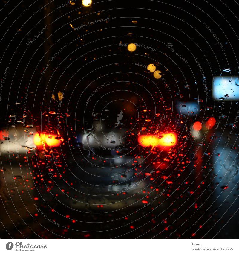 Spatial density blurred. Bad weather Rain Transport Traffic infrastructure Passenger traffic Motoring Street Car Rear light Brake light Traffic jam Dark Wet