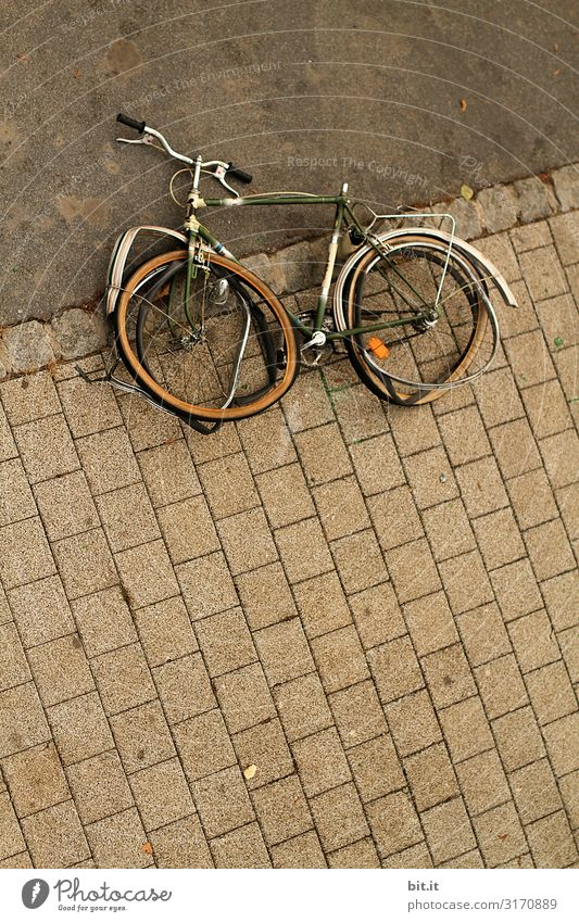 Old, broken bicycle lies on the sidewalk Transport Means of transport Traffic infrastructure Cycling Lie Broken Integrity Anger Aggravation Revenge Aggression