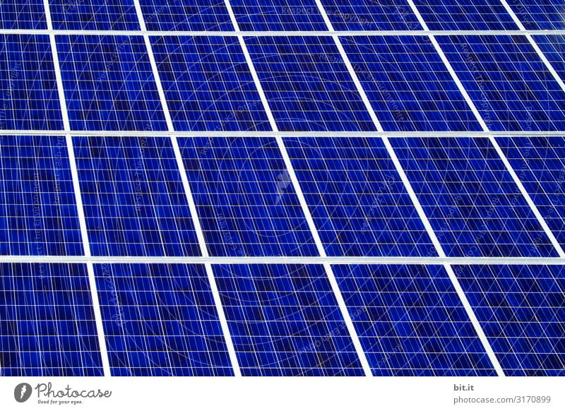 Solar cells of a photovoltaic system on the roof of a house, for renewable, sustainable power generation for climate protection. Environment Nature Climate