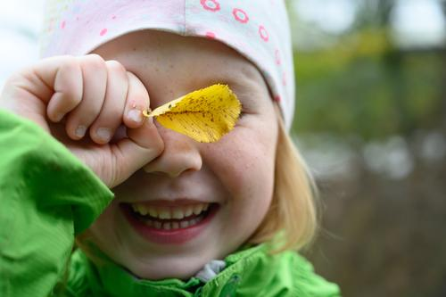 autumn child Face Parenting Kindergarten Child Girl Smiling Laughter Exterior shot Copy Space right