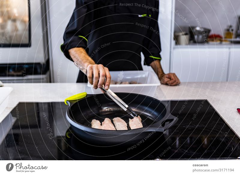 Chef frying a bass on a restaurant Human being Youth (Young adults) Man Green Young man Hand Dish Relaxation Black 18 - 30 years Food Eating Lifestyle Adults