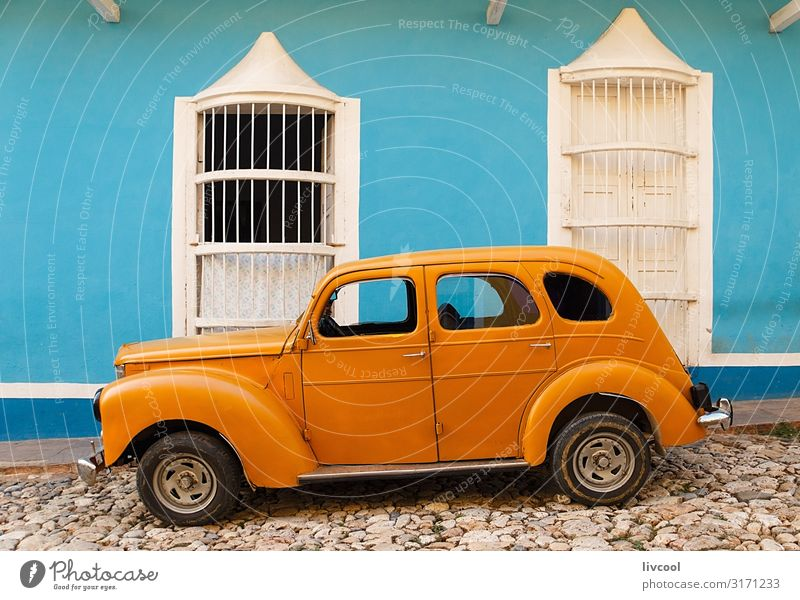 old orange car parked in front of blue house , trinidad - cuba Lifestyle Vacation & Travel Tourism Trip Island House (Residential Structure) Decoration Art