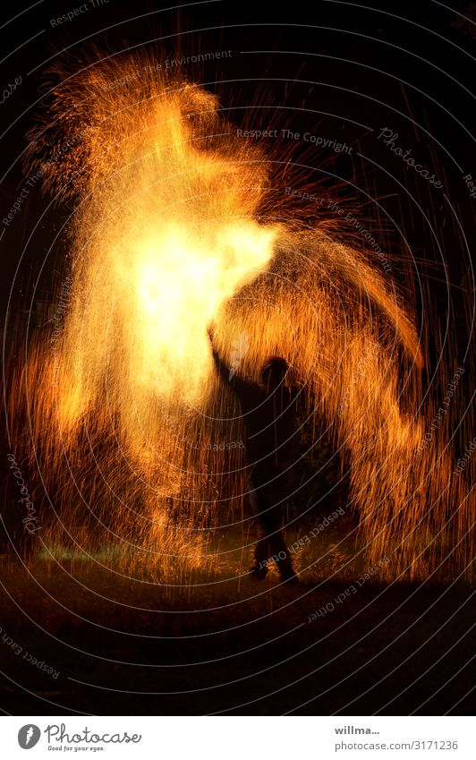 Playing with fire - Man in the midst of spark fire Fire Spark Human being Silhouette Hot Threat Magic Elements shower of sparks magic Uniqueness Fire show Shows