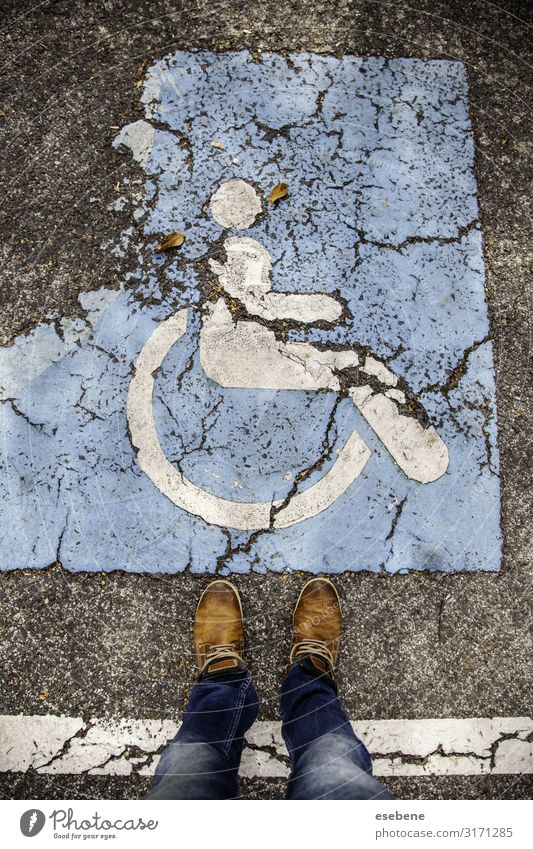 Disabled sign on the asphalt Medication Chair Human being Park Places Transport Street Car Stripe Blue White Safety invalid signal care Priority Parking painted
